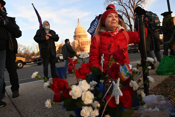 Melody Black cries on Thursday, Jan. 7, 2021, at a memorial for Ashli Babbitt outside the Capitol, where she was shot and killed in a riot the day before. Washington Post photo by Matt McClain
