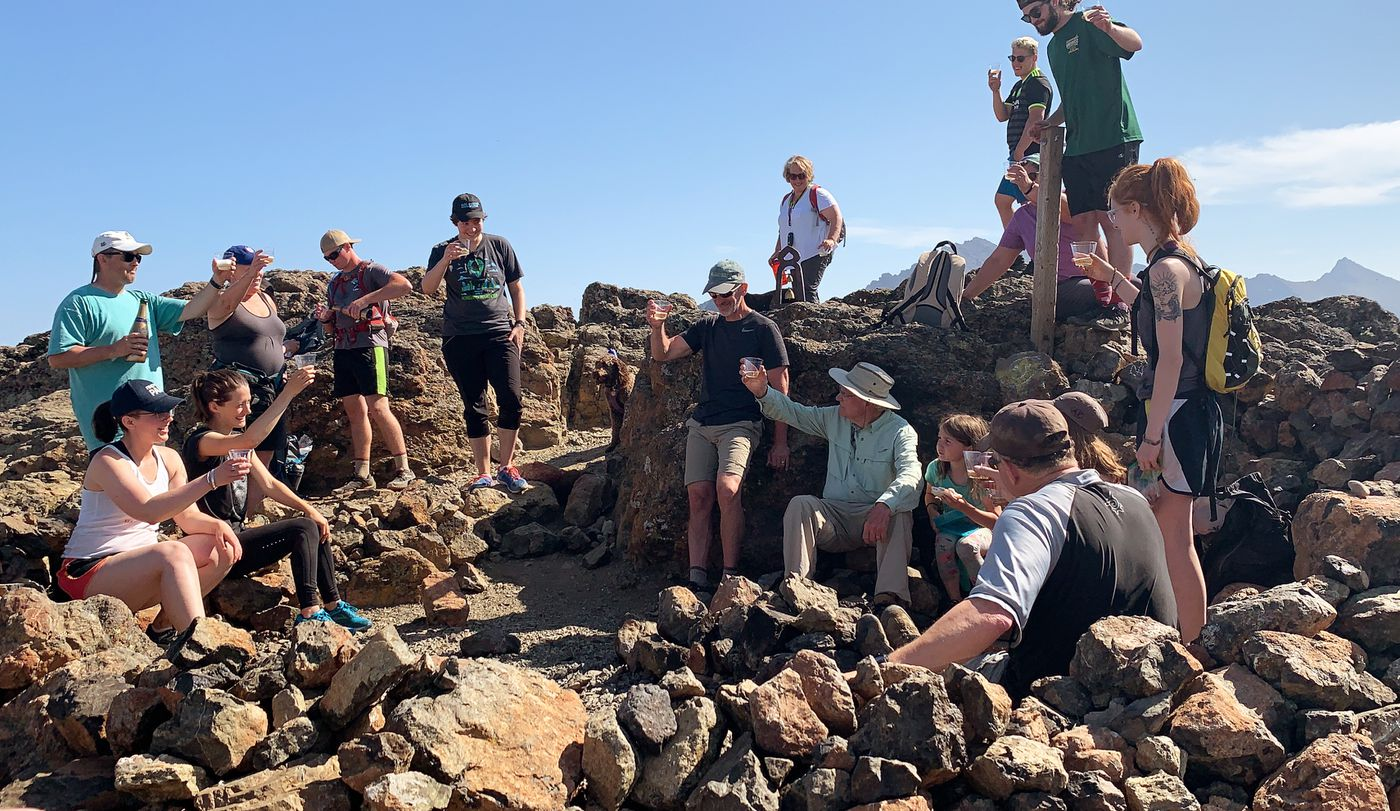 George Wooliver leads a toast to his family after reaching the top of Flattop Mountain in Chugach State Park on Friday, July 5, 2019. (Matt Tunseth / ADN)