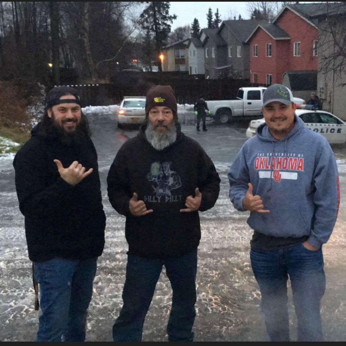 Clint Greathouse of Anchorage (left) celebrates the recovery of his stolen truck with Alaska A-Team members Floyd Hall and Chad Martin on Sunday, Nov. 18, 2018. (Photo by Patty Greathouse)
