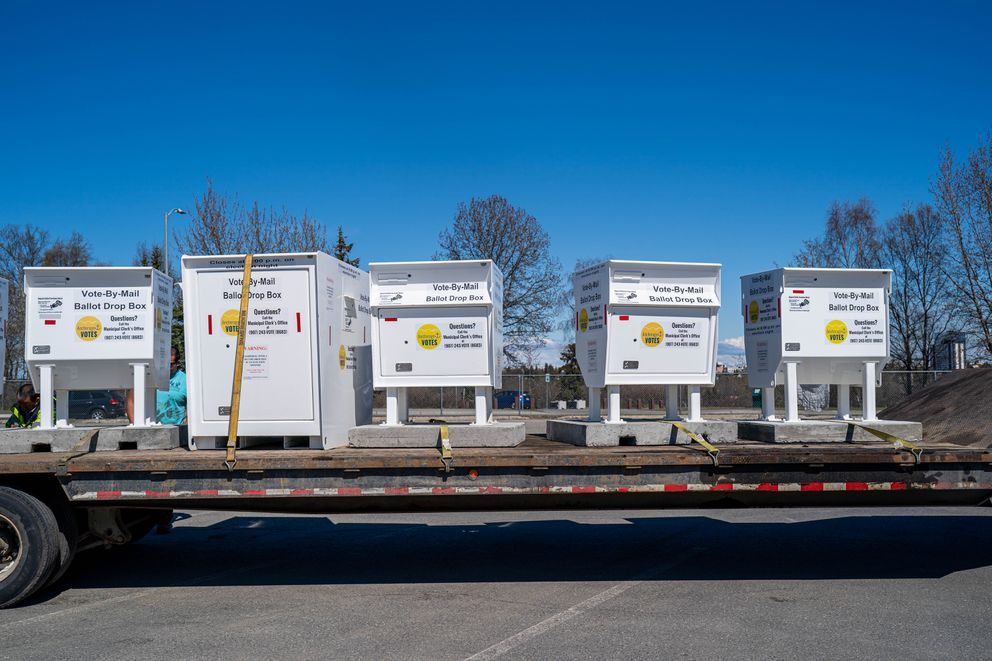Vote by mail ballot drop boxes are collected on a flatbed trailer at West High on Thursday, May 13, 2021, in preparation for their transport to the municipal election center. (Loren Holmes / ADN)