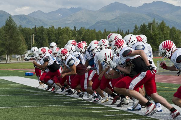 "The T-Birds take the field after a water break. East High football gathered for its first regular season practice on Wednesday, July 31, 2019. Head coach Jeff Trotter said he's not running practice at full intensity yet, but other camps have helped. ""We're actually not to far off where we want to be, at least for this point,"" Trotter said. The East T-Birds won the state championship last season. Trotter said he thinks his strategy of rotating players in and out of the game will help maintain some momentum heading into this season. ""We lost some really good talent, but the guys coming back (are) very experience because they have a lot of game time,"" he said. East opens its season with a home game against Colony on August 16. (Marc Lester / ADN)"