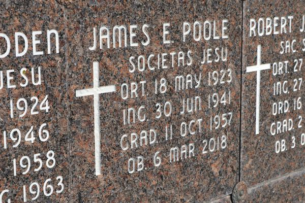 This Oct. 22, 2018 photo shows the marker for where the remains of Rev. James Poole are interned at Mount St. Michael in Spokane, Wash. Over the course of his life, Poole was accused of sexually abusing at least 20 women. (Emily Schwing/Reveal via AP)