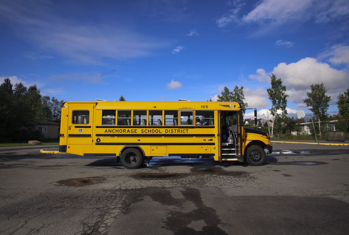 An Anchorage School District school bus used to deliver personal computers to families in preparation for the first day of school in Anchorage, on Aug. 19, 2020. (Emily Mesner / ADN)
