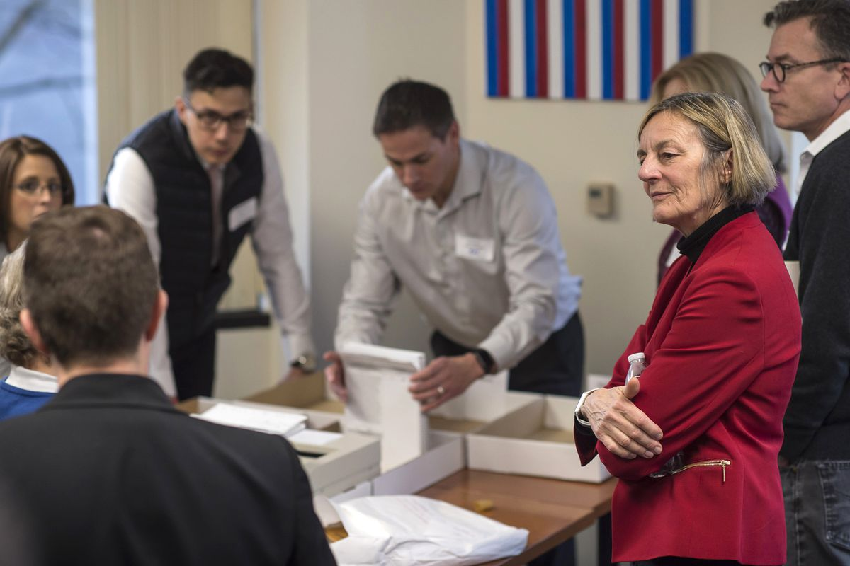 Alaska House District 1 candidate Democrat Kathryn Dodge, right, watches the election recount at the Department of Elections' Juneau office on Friday, Nov. 30, 2018. (Michael Penn/The Juneau Empire via AP)