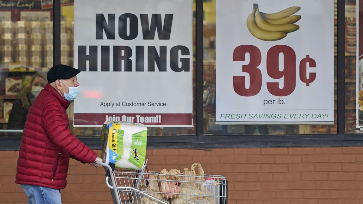 A man walks out of a store in Mayfield Heights, Ohio. (AP Photo/Tony Dejak, File)