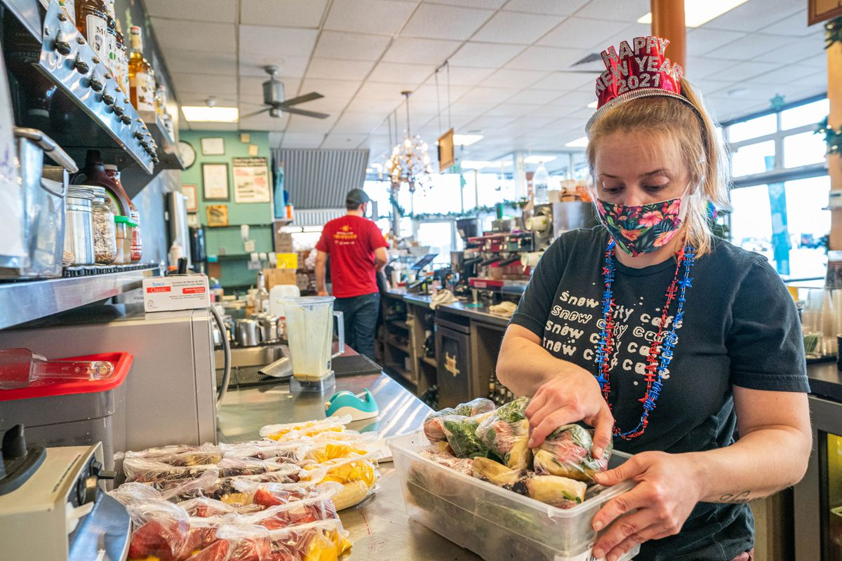 Lauren Cronin preps bags for smoothies at Snow City Cafe on Thursday, Dec. 31, 2020 ahead of the re-opening of dine-in service for Anchorage restaurants on Jan. 1. (Loren Holmes / ADN)