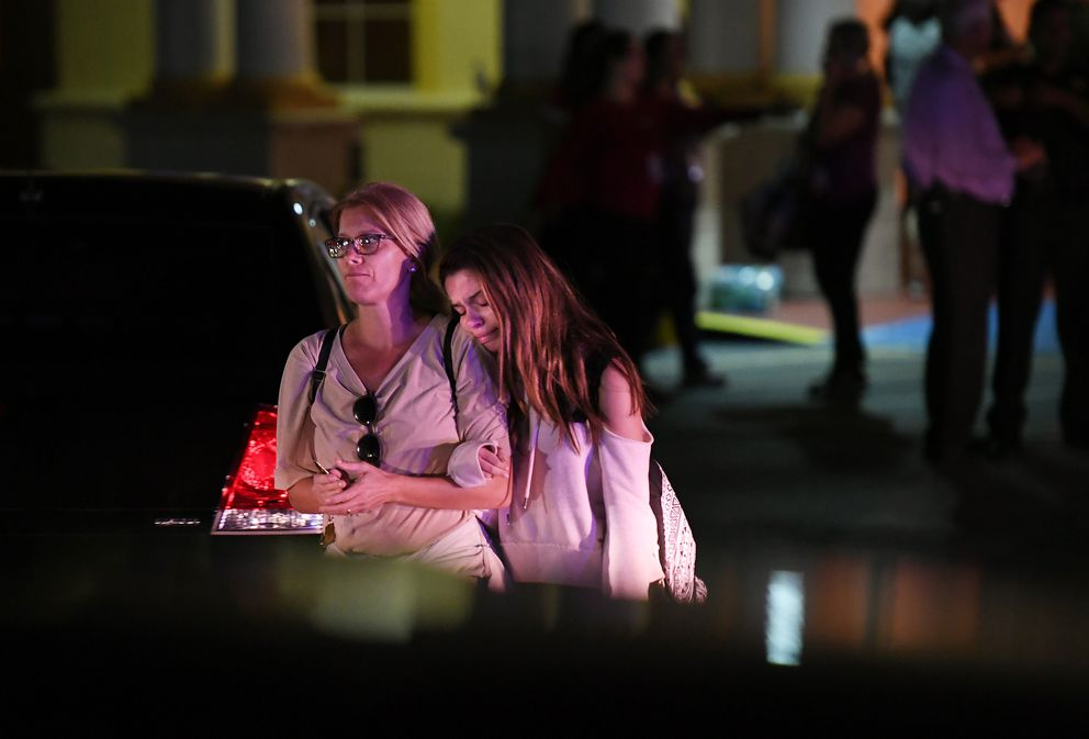 Reunited relatives leave the Marriott Coral Springs Hotel on Wednesday night following a deadly shooting at Marjory Stoneman Douglas High School. Washington Post photo by Matt McClain