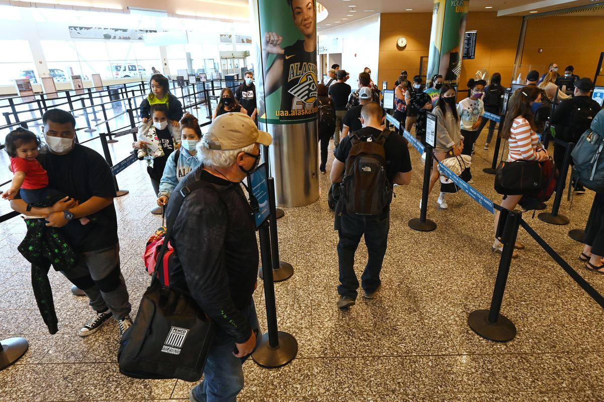 People wait in line at the Transportation Security Administration (TSA) screening checkpoint at Ted Stevens Anchorage International Airport on Monday, June 14, 2021. (Bill Roth / ADN)