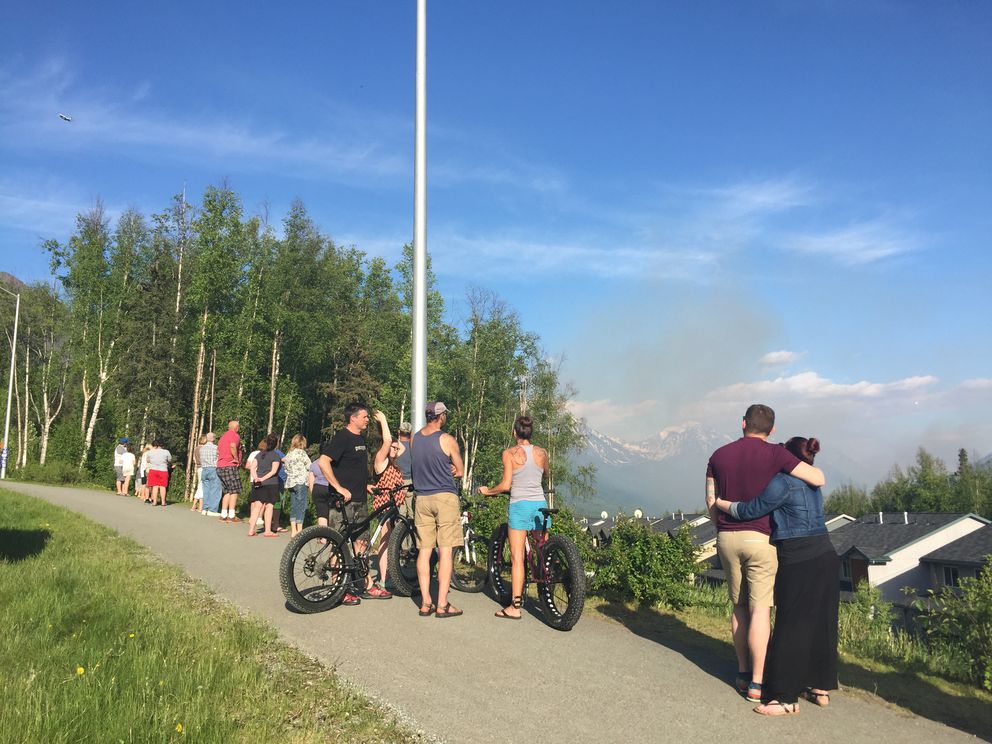 People gathered off Driftwood Bay Drive in Eagle River to watch the smoke of the nearby wildfire Friday evening, May 27, 2016. (Tegan Hanlon / Alaska Dispatch News)