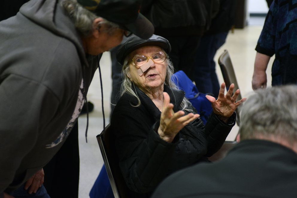 Bev Aleck is greeted at the conclusion of presentations and audience comment on Wednesday. Her husband, Nick, helped drill the mile-deep pit for the Cannikin test, which took place in 1971. He died of leukemia in 1975. (Erik Hill / Alaska Dispatch News)