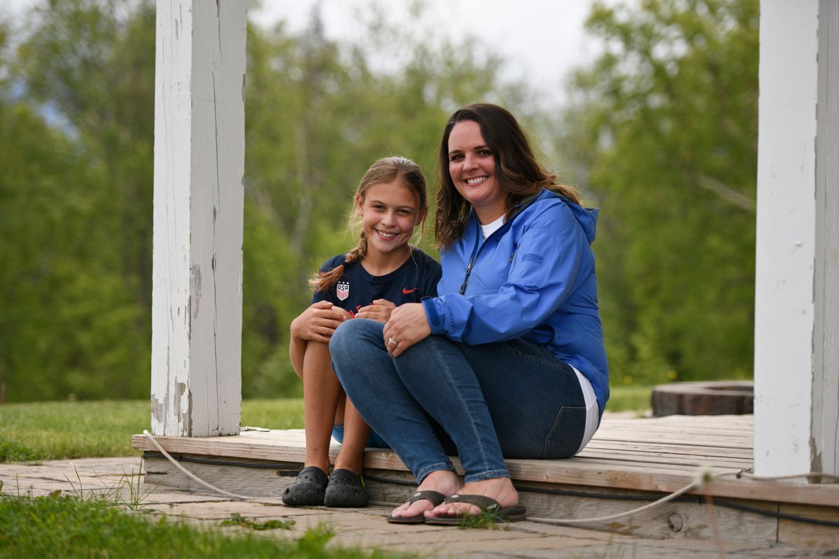 Eleven-year-old Aubrey Virgin's medical condition puts her at higher risk if she were infected by COVID-19. Aubrey, left, sits with her mother, Shannon Virgin at the family's Palmer home on June 26, 2020. (Marc Lester / ADN)