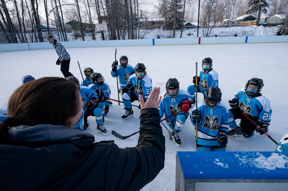 Scotty Gomez Foundation hockey director Mandy Reale talks with her team before a game against the South Anchorage Drillers at Tikishla Park on Saturday, Feb. 6, 2021. (Loren Holmes / ADN)