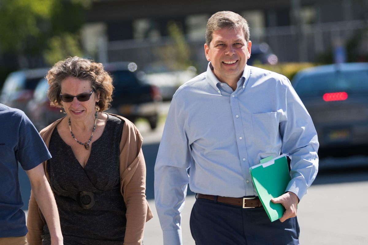 Mark Begich, with his wife Deborah Bonito, walks into the state Division of Elections office to file to run for governor June 1. (Loren Holmes / ADN archive)