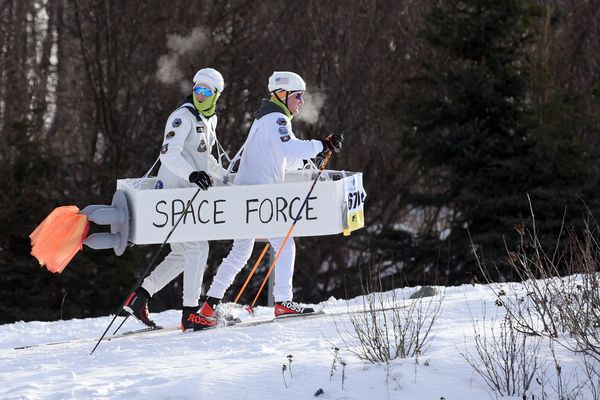 Service's Hayden Ulbrich, left, and Matthew Terry ski together as members of the Space Force at the East T-Bird Mixed Relay cross country races on Saturday, Feb. 15, 2020 at Kincaid Park in Anchorage. (Matt Tunseth / ADN)