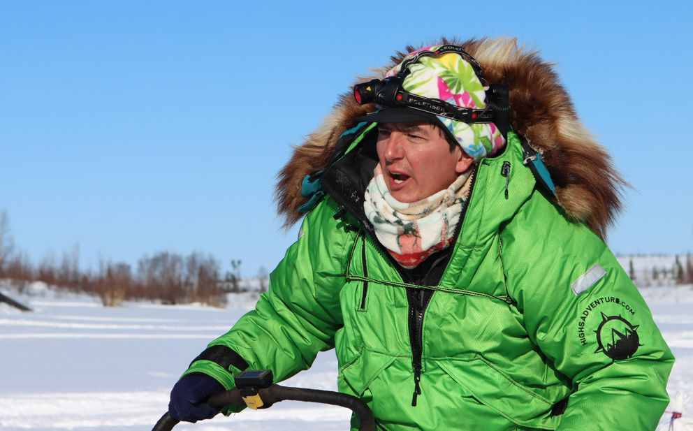 Ryan Redington stayed in the Iditarod checkpoint for a few minutes before heading out on the in-bound trail. (Zachariah Hughes/for ADN)