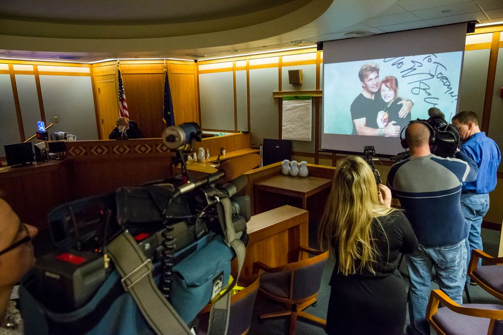 Judge Kevin Saxby and members of the media watch a slideshow of Jordyn Durr on Friday, February 6, 2015 in an Anchorage courtroom. Jordyn and her best friend Brooke McPheters, also 15 years old, were killed in 2013 by Stacey Allen Graham, who was sentenced to 32 years in prison. (Loren Holmes / ADN)
