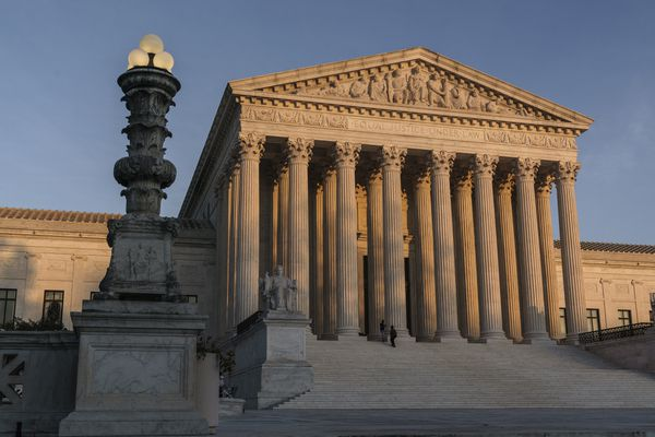 FILE - In this Nov. 6, 2020, file photo the Supreme Court is seen as sundown in Washington. The Supreme Court rejected on Dec. 11,a lawsuit backed by President Donald Trump to overturn Joe Biden's election victory, ending a desperate attempt to get legal issues rejected by state and federal judges before the nation's highest court. (AP Photo/J. Scott Applewhite, File)