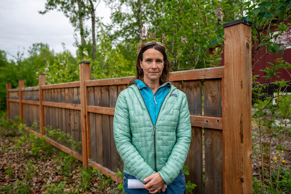Caitlin Palmer stands outside her home, near the site of the planned Big Dipper Balloon Company, on Wednesday, June 9, 2021 in Talkeetna. (Loren Holmes / ADN)