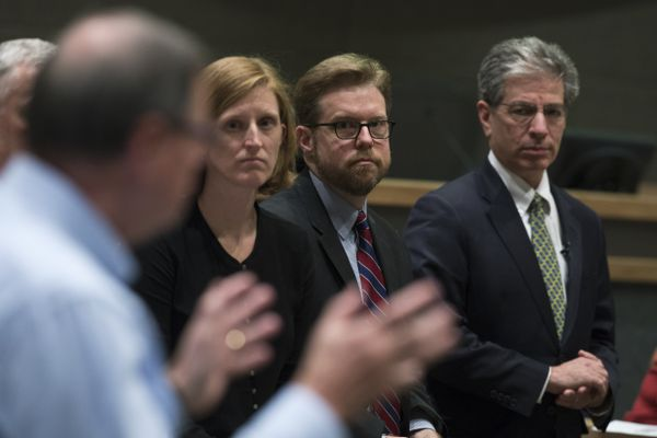 Anchorage city attorney Rebecca Windt Pearson, city manager Bill Falsey and mayor Ethan Berkowitz listen as Chugach Electric CEO Lee Thibert makes comments. Representatives from Chugach Electric, Municipal Light and Power and the mayor's office gave a presentation and answered questions about the proposed Chugach purchase of ML&P on March 5, 2018, at the Anchorage Assembly Chambers. (Marc Lester / ADN)