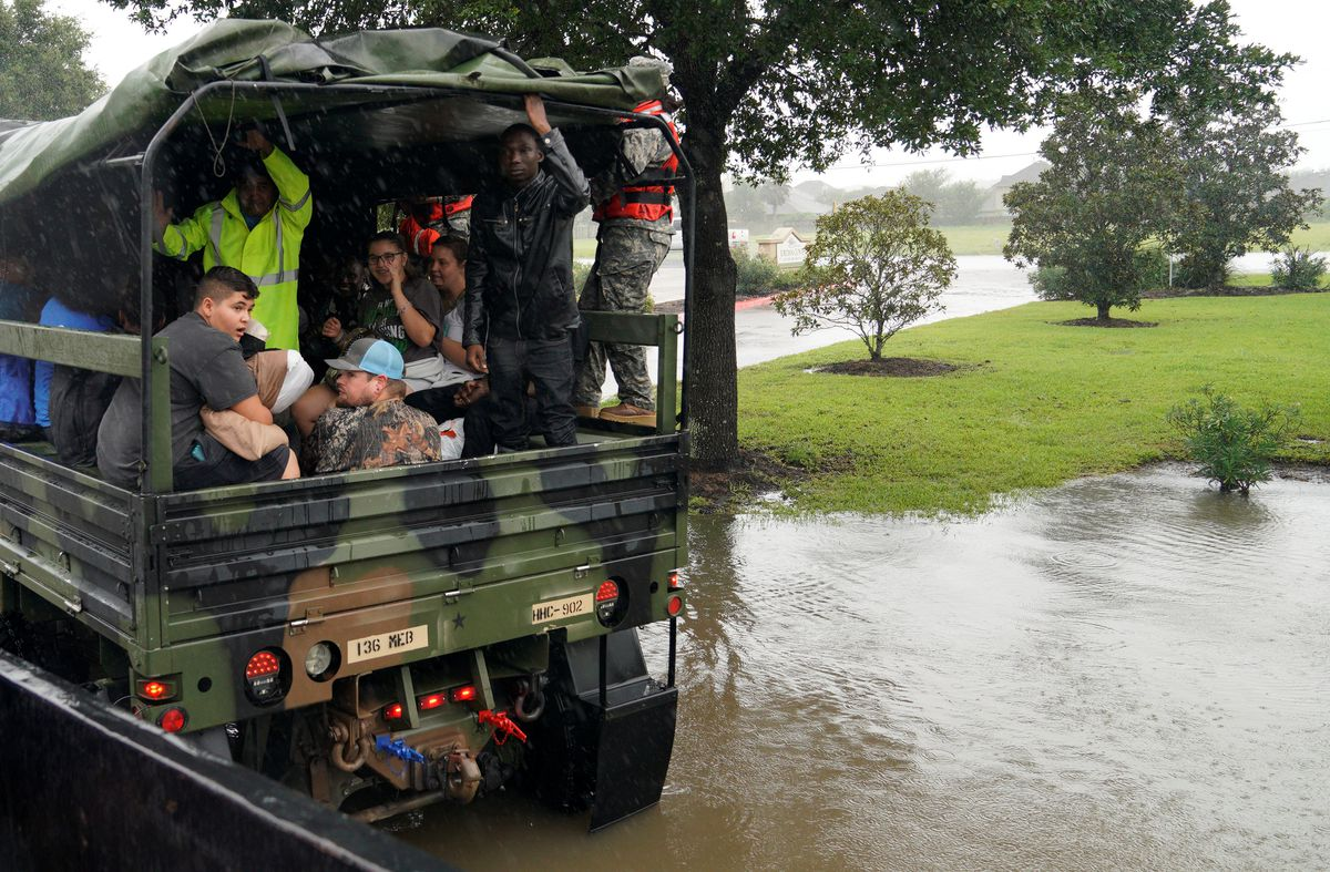 People are evacuated by a high-water truck from the Hurricane Harvey floodwaters in Dickinson, Texas, on Monday. (Rick Wilking / REUTERS)