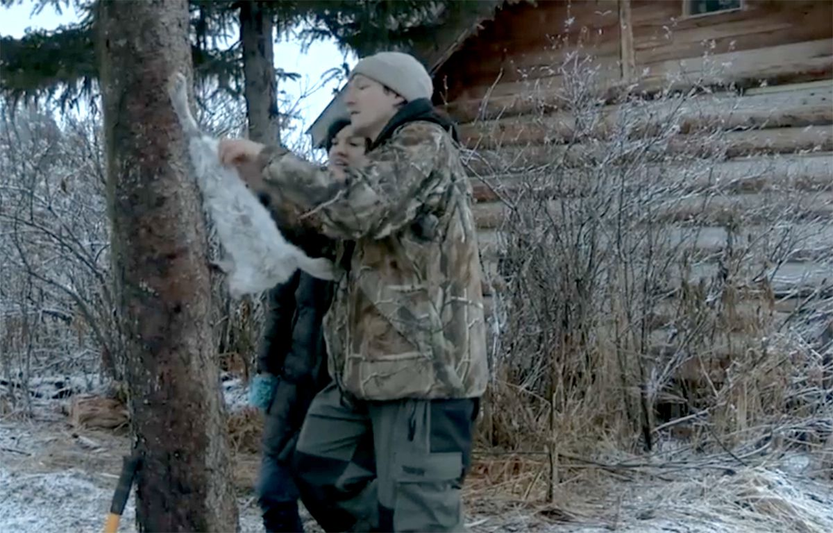 "Atz Lee and Jane Kilcher tackle a dirty job on ""Alaska: The Last Frontier."" (Discovery Channel)"