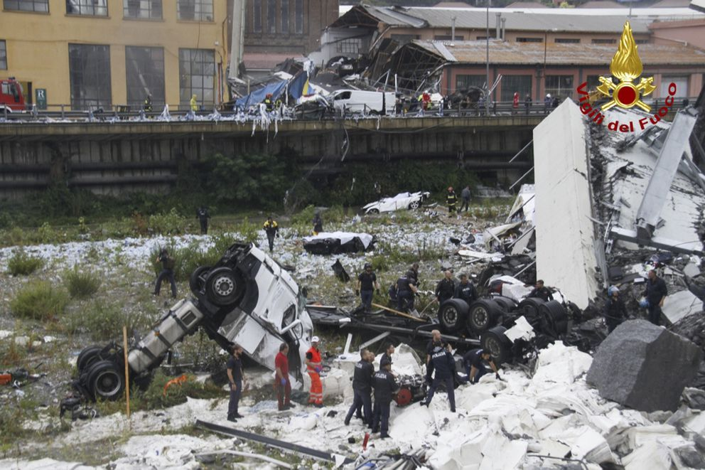 This photo released by the Italian firefighters, cars are seen among the rubble of the collapsed Morandi highway bridge in Genoa, northern Italy, Tuesday, Aug. 14, 2018. A bridge on a main highway linking Italy with France collapsed in the Italian port city of Genoa during a sudden, violent storm, sending vehicles plunging 90 meters (nearly 300 feet) into a heap of rubble below. The Interior Ministry said at least 11 people were killed and five seriously injured. (Vigili Del Fuoco via AP)