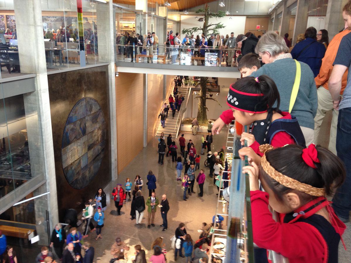 People flood the new Alaska State Library, Archive and Museum as it opened Monday, June 6, 2016. (Charles Wohlforth / Alaska Dispatch News)