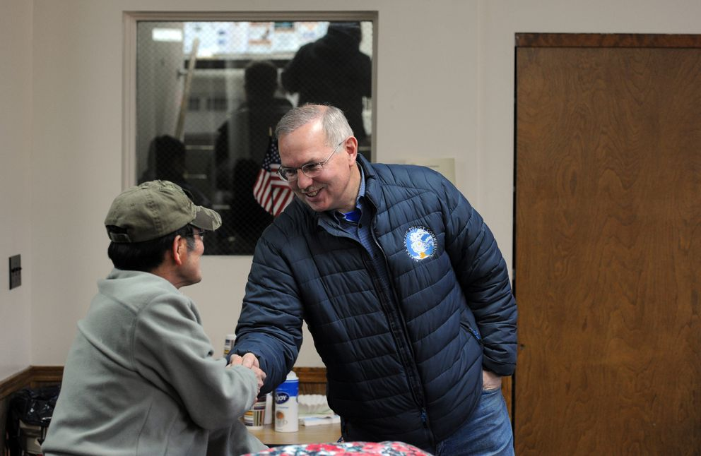 Rep. Bryce Edgmon pauses to accept congratulations on his new role as Speaker of the House during a break in testimony at a public hearing with the visiting state Local Boundary Commission on Tuesday in Dillingham. (Erik Hill / Alaska Dispatch News)