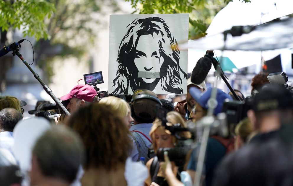 A portrait of Britney Spears looms over supporters and media members outside a court hearing concerning the pop singer's conservatorship at the Stanley Mosk Courthouse, Wednesday, June 23, 2021, in Los Angeles. (AP Photo/Chris Pizzello)