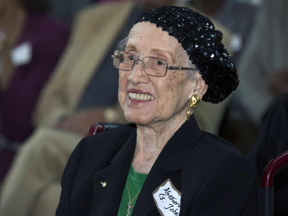 FILE - In this Feb. 22, 2016, file photo, provided by NASA, Katherine G. Johnson is honored at the Virginia Air and Space Center in Hampton, Va. Johnson, 101, a mathematician who calculated rocket trajectories and earth orbits for NASA's early space missions and was later portrayed in the 2016 hit film 'Hidden Figures, ' about pioneering Black female aerospace workers, died, Feb. 24. (NASA via AP, File)