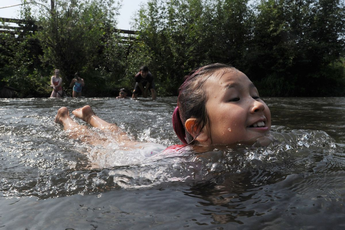 Nine-year-old Mischa Richar floats in the cool water of Campbell Creek while beating the heat on Monday, July 8, 2019. (Bill Roth / ADN)