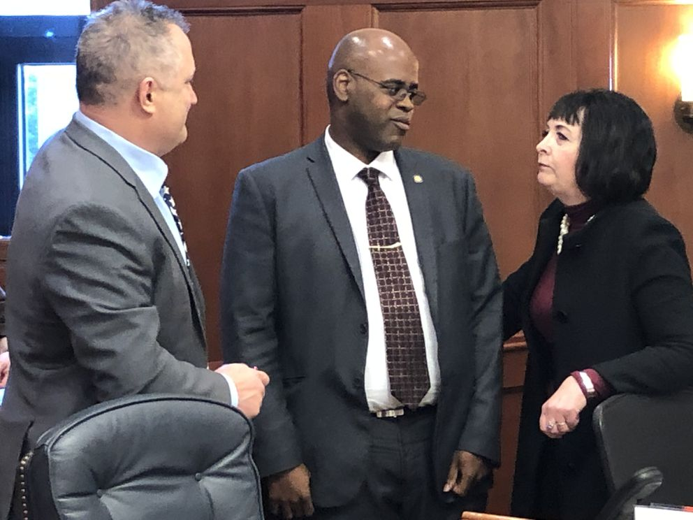 From left to right, Sens. Mike Shower, R-Wasilla; David Wilson, R-Wasilla; and Shelley Hughes, R-Palmer; talk during a break in the debates of the Alaska Senate on Monday, March 23, 2020. (James Brooks / ADN)