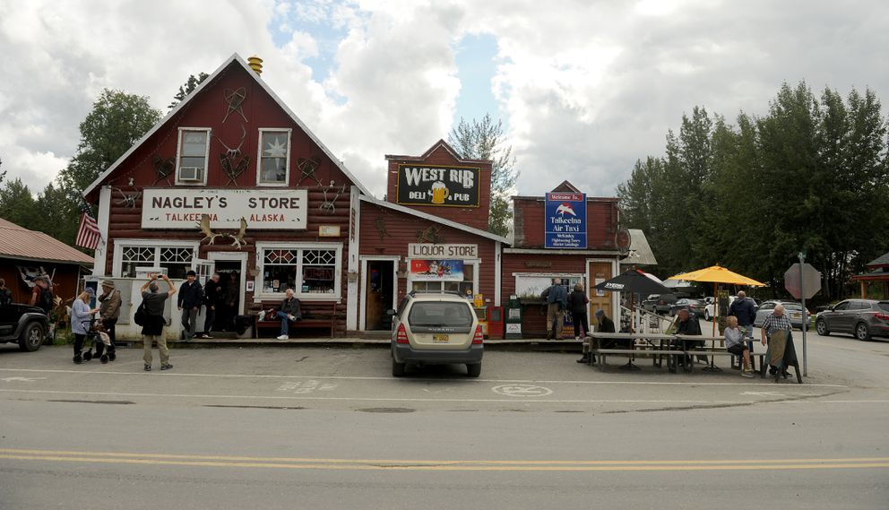 Tourists check out Nagley's Store in downtown Talkeetna. (Bob Hallinen / Alaska Dispatch News)