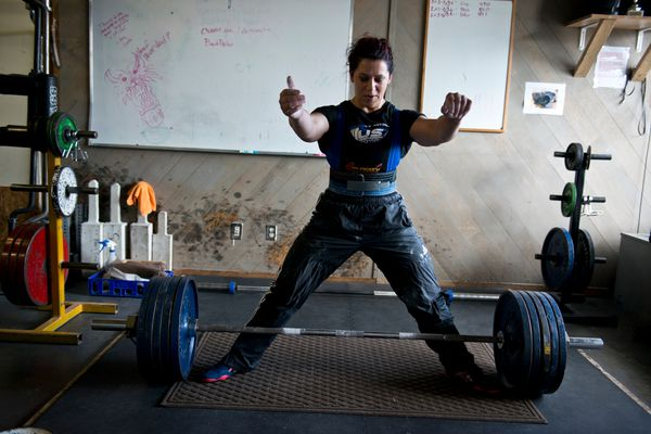 Priscilla Ribic prepares to deadlift 501 pounds during training at Southside Strength and Fitness on July 14, 2017. Ribic, of Anchorage, has won 15 world championships in her hall-of-fame powerlifting career. She currently holds four world records. (Marc Lester / Alaska Dispatch News)