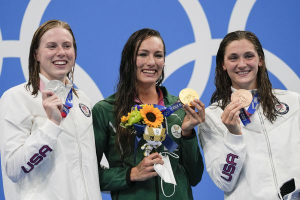 From left, Lilly King, of United States, Tatjana Schoenmaker, of South Africa, and Annie Lazor, of United States, pose at the podium after the women's 200-meter breaststroke final at the 2020 Summer Olympics, Friday, July 30, 2021, in Tokyo, Japan. (AP Photo/Gregory Bull)