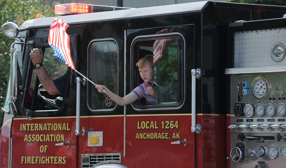 Many fire department vehicles, old and new, were part of Anchorage's Fourth of July parade. (Anne Raup / ADN)