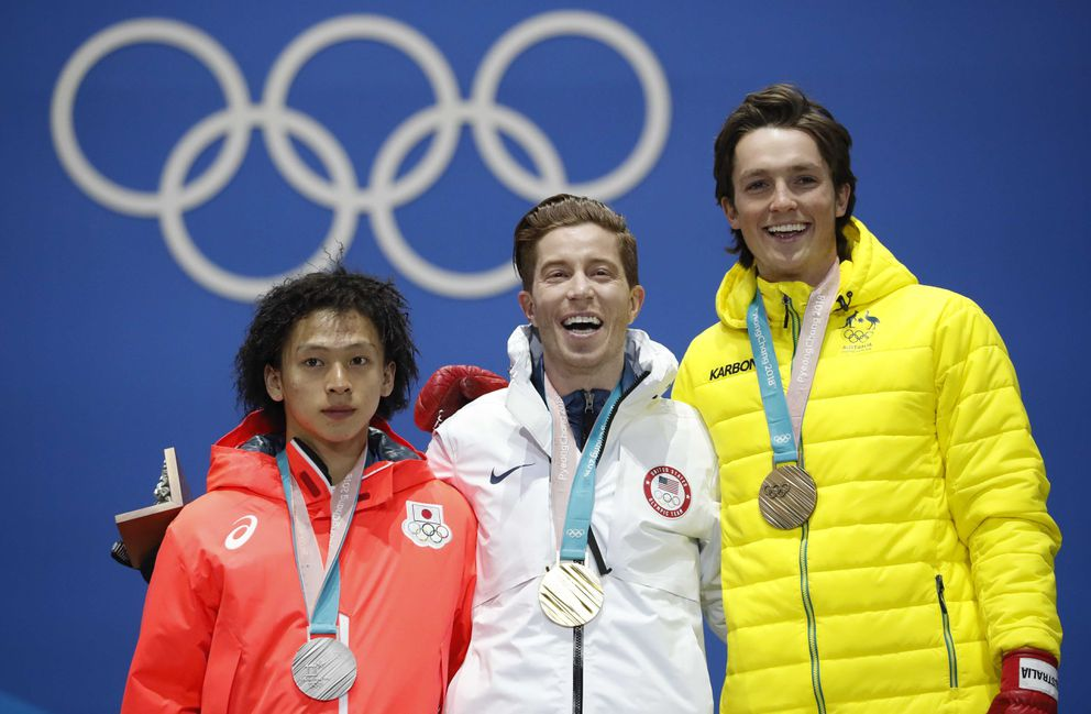 Gold medalist Shaun White of the U.S., silver medalist Ayumu Hirano of Japan and bronze medalist Scotty James of Australia on the podium. REUTERS/Kim Hong-Ji