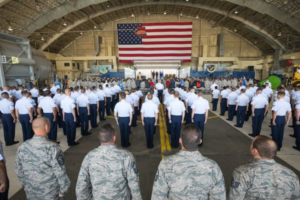 Members of the 673d Air Base Wing stand at attention during a change of command ceremony Friday at JBER. (Loren Holmes / ADN)