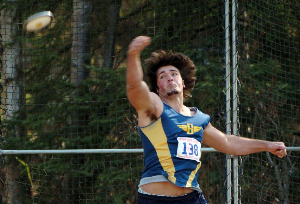 Olympic shot put hopeful Jordan Clarke of Anchorage unleashes a discus throw for Bartlett in 2007. Clarke, who competes in the Olympic Trials on Friday, still owns the boys state shot put and discus records. (Erik Hill / ADN archive 2007)