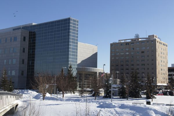 The Rabinowitz Courthouse contrasts the Polaris Building on March 17, 2017, in downtown Fairbanks. This perspective of the buildings taken from the pedestrian bridge over the Chena River distorts the height of the buildings. The Rabinowitz Courthouse is approximately 61 feet tall with its five stories. The Polaris building is approximately 134 feet with its 11 stories, according to emporis.com, a global provider of building information. (Rugile Kaladyte / Alaska Dispatch News)