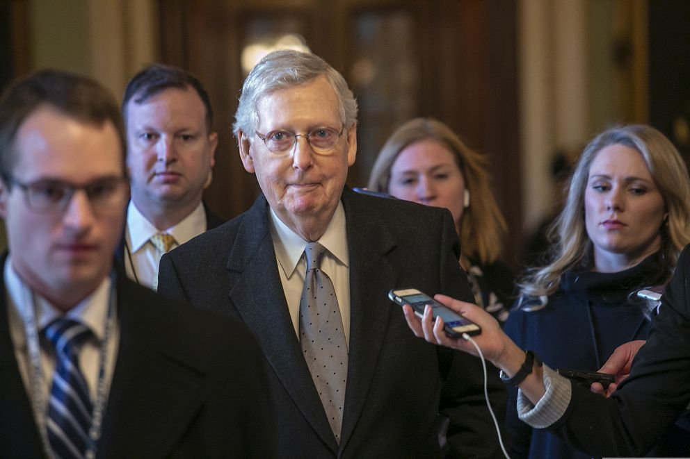 Senate Majority Leader Mitch McConnell, R-Ky., leaves the chamber on Tuesday. (AP Photo/J. Scott Applewhite)