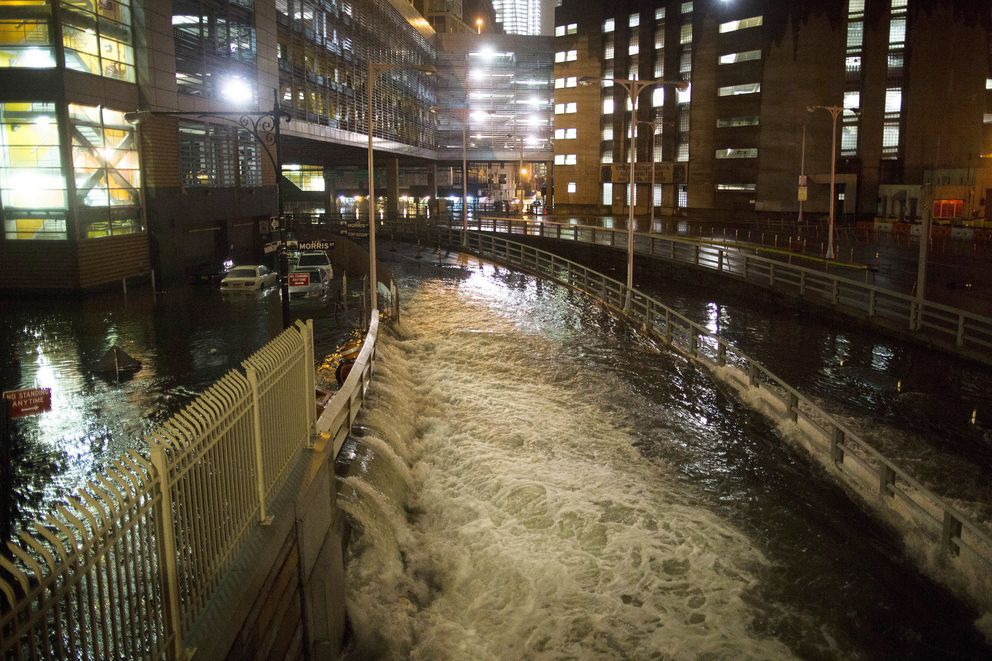 FILE - In this Oct. 29, 2012 file photo, seawater floods the entrance to the Brooklyn Battery Tunnel during Superstorm Sandy in New York. Disaster experts say people have to think about the big disaster that happens only a few times a lifetime at most, but is devastating when it hits —Hurricane Katrina,Superstorm Sandy, the2011 super outbreak of tornadoes, the 1906San Francisco earthquakeor a horrible pandemic. (AP Photo/ John Minchillo, File)