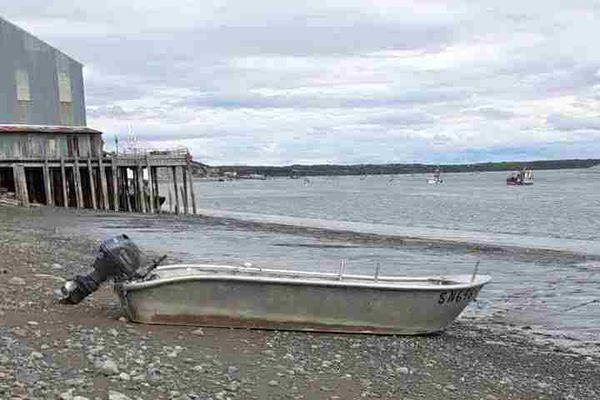 John Schandelmeier's Carlson skiff sits on the beach in front of the Red Salmon Cannery this week in Naknek. Schandelmeier, a commercial fisherman, crossed Cook Inlet and Iliamna Lake in the 21-foot boat in June 2021. (Photo by John Schandelmeier)