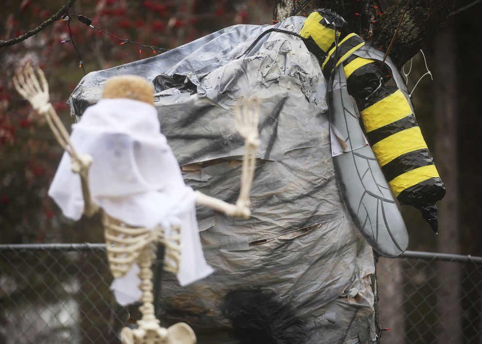 A scene depicting a murder hornet takeover is used as Halloween decorations outside a home near Wiley Post Avenue and Balchen Drive in Anchorage on Oct. 28, 2020. (Emily Mesner / ADN)