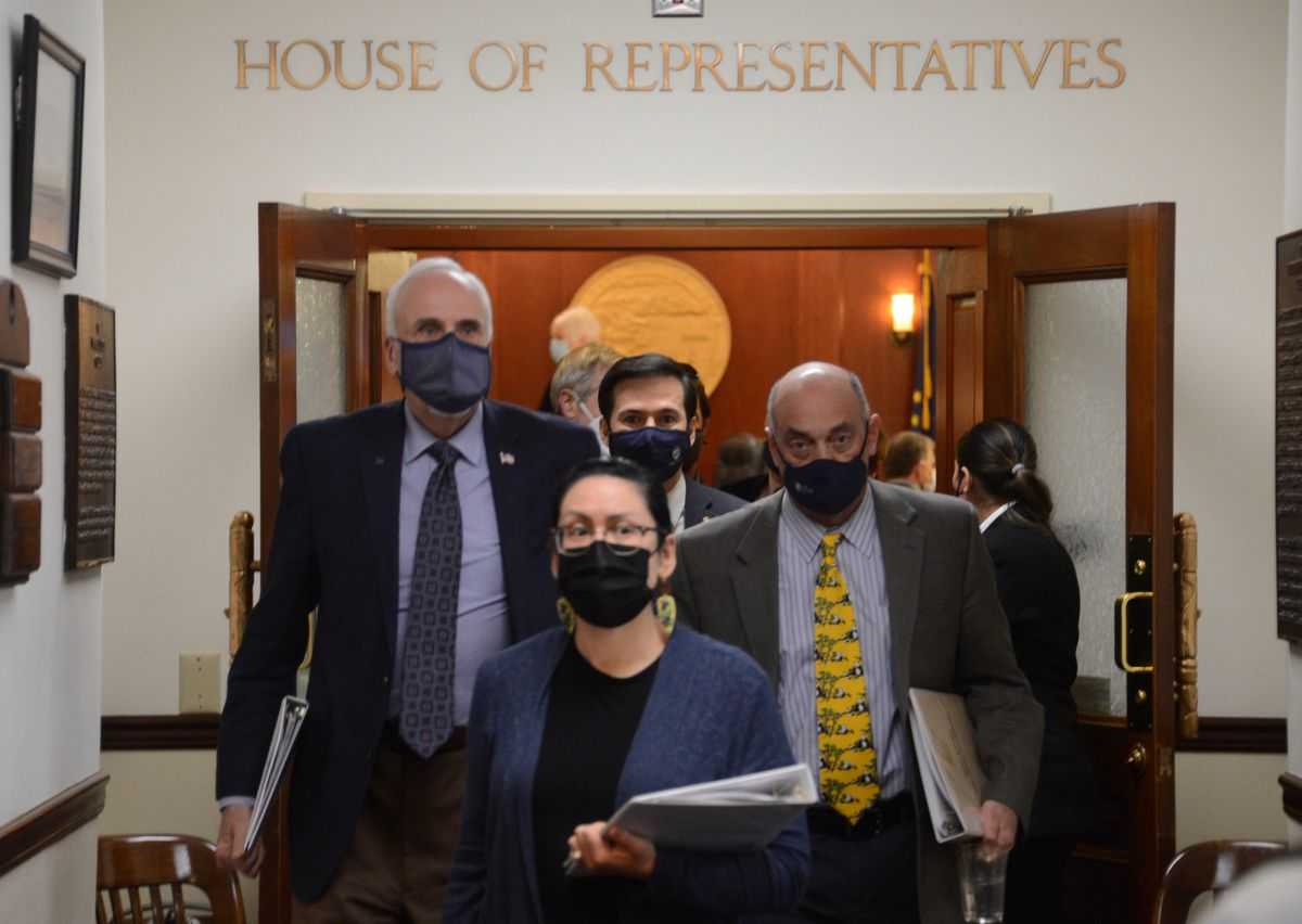 Alaska lawmakers leave a session of the Alaska House of Representatives on Thursday, April 22, 2021 at the Alaska State Capitol in Juneau. (James Brooks / ADN)