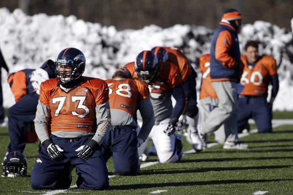 Denver Broncos guard Chris Kuper (73) and teammates stretch during practice Wednesday, Jan. 29, 2014, in Florham Park, N.J. The Broncos are scheduled to play the Seattle Seahawks in the NFL Super Bowl XLVIII football game Sunday, Feb. 2, in East Rutherford, N.J. (Mark Humphrey / Associated Press