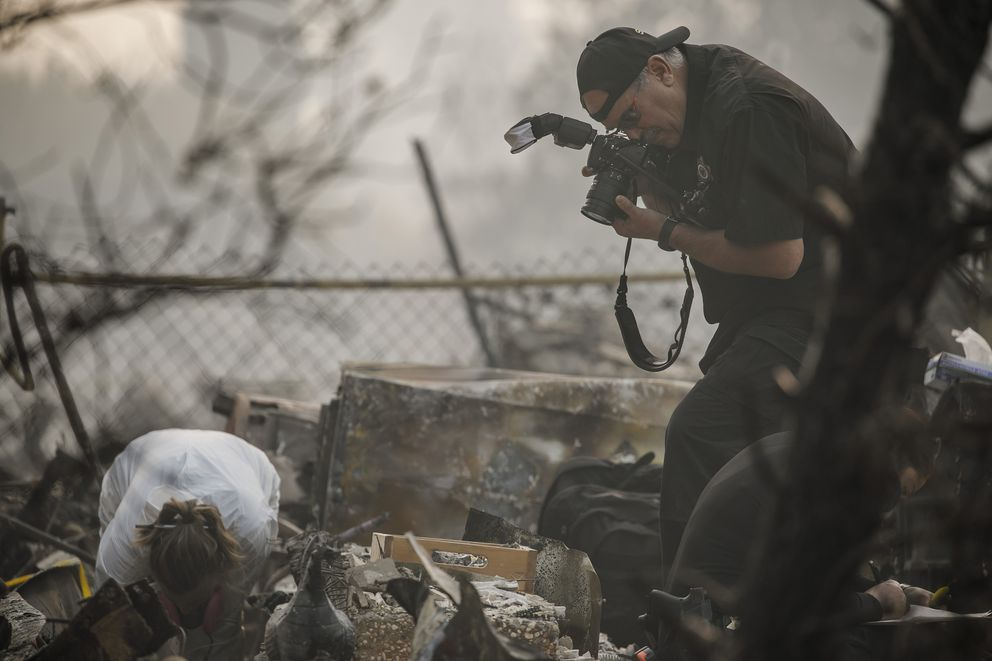 A search and rescue team collects and documents suspected human remains from an apartment complex burned down in the Camp fire in Paradise, Calif., on Friday, Nov. 16, 2018. (Marcus Yam/Los Angeles Times/TNS)