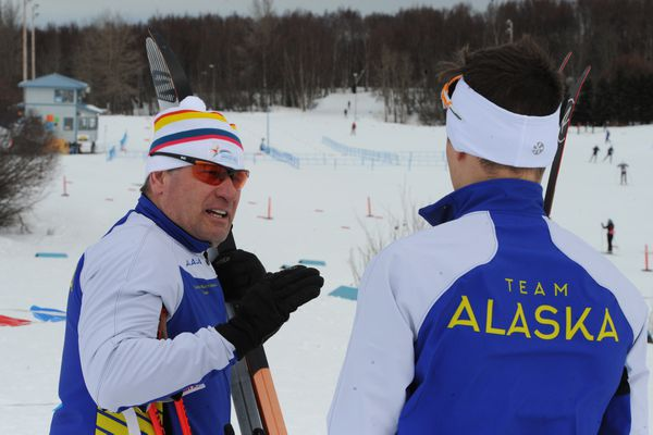 Team Alaska coach Jan Buron talks to Alexander Maurer during training at Kincaid Park on Sunday, March 10, 2019, in preparation for the Junior National cross country championships this week. (Bill Roth / ADN)