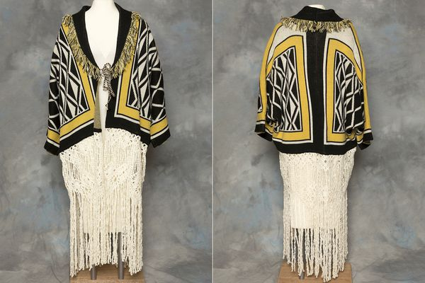 This combination of photos provided by the Sealaska Hertiage Institute in Juneau, Alaska, shows the front and back of a Tlingit Ravenstail coat. An Alaska Native cultural organization and the luxury department store Neiman Marcus have settled a lawsuit over the sale of a coat with a copyrighted, geometric design borrowed from indigenous culture. (Brian Wallace/Sealaska Heritage Institute via AP)