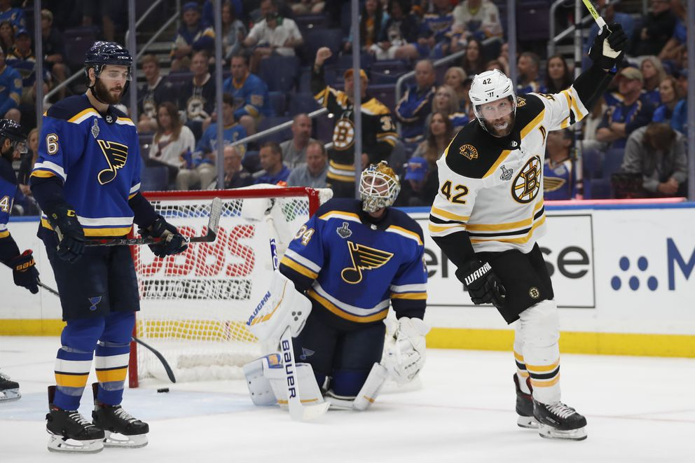 Boston Bruins right wing David Backes (42) celebrates after a shot by teammate Marcus Johansson, not shown, got past St. Louis Blues goaltender Jake Allen (34) for a score during the third period of Game 3 of the NHL hockey Stanley Cup Final Saturday, June 1, 2019, in St. Louis. The Bruins won 7-2 and lead the series 2-1. At left is Blues' defenseman Joel Edmundson (6). (AP Photo/Jeff Roberson)